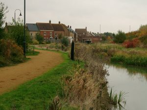 Photo of canal with grass mown
