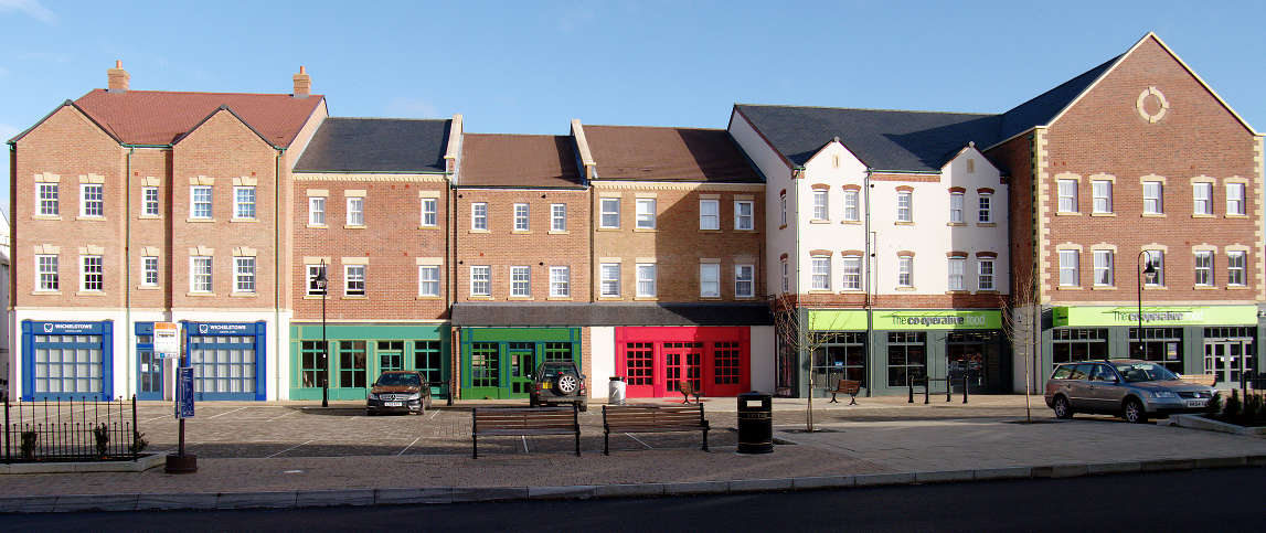 The parade of shops on East Wichel Way
